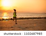 young woman running at sunset... | Shutterstock . vector #1102687985