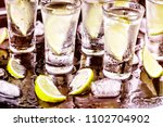 tequila shot with lime and sea... | Shutterstock . vector #1102704902