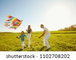 happy family with a kite...   Shutterstock . vector #1102708202