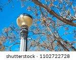 antique streetlamp on blue sky... | Shutterstock . vector #1102722728