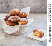 doughnuts with creamy lemon... | Shutterstock . vector #1102723502