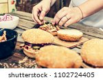 preparing delicious burgers.... | Shutterstock . vector #1102724405