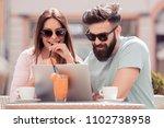 beautiful couple having coffee... | Shutterstock . vector #1102738958