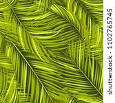 seamless pattern of palm leaves.... | Shutterstock .eps vector #1102765745