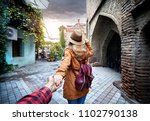 woman in hat and brown jacket... | Shutterstock . vector #1102790138