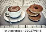 hot cappuccino with donuts on white wooden floor - stock photo