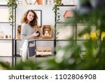 view through blurry leaves on a ...   Shutterstock . vector #1102806908