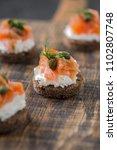 mini sandwiches with cream... | Shutterstock . vector #1102807748