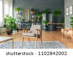a chair standing on a patterned ...   Shutterstock . vector #1102842002