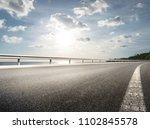 Empty Road With Coastline...