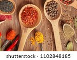 variety of spices in spoons on... | Shutterstock . vector #1102848185