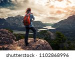 tourist hiker with red backpack ... | Shutterstock . vector #1102868996