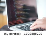 closeup coding on screen  woman ... | Shutterstock . vector #1102885202