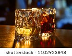 two glasses of whiskey and ice... | Shutterstock . vector #1102923848