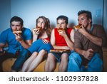 football fans on the couch near ... | Shutterstock . vector #1102937828