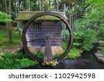 Old Wooden Water Wheel In The...