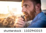 a man with a red beard smokes a ...   Shutterstock . vector #1102943315
