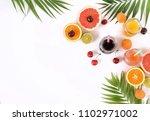 assortment of natural juices in ... | Shutterstock . vector #1102971002