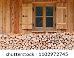 timber house window with... | Shutterstock . vector #1102972745