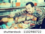 smiling guy deciding on best... | Shutterstock . vector #1102980722