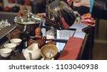 tea ceremony. tea maker pours... | Shutterstock . vector #1103040938