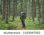 man in forest backpacking... | Shutterstock . vector #1103047052
