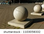 stone balls on a city street.... | Shutterstock . vector #1103058332