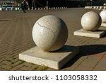 stone balls on a city street.... | Shutterstock . vector #1103058332