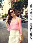 beautiful brunette young woman... | Shutterstock . vector #1103079482