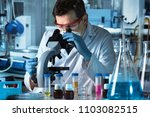 microbiologist working with... | Shutterstock . vector #1103082515