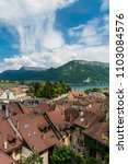 Small photo of Beautiful glimpse of Lake Annecy and tiled rooftops