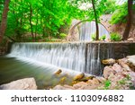 double waterfalls at... | Shutterstock . vector #1103096882