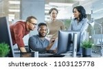 in busy corporate office team... | Shutterstock . vector #1103125778