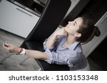 woman in her house looks... | Shutterstock . vector #1103153348