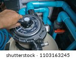 clear the sand filter of the... | Shutterstock . vector #1103163245
