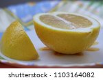 close   up of lemon on a plate | Shutterstock . vector #1103164082