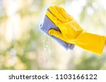 a female hand in bright yellow... | Shutterstock . vector #1103166122