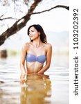 sexy girl posing in water.... | Shutterstock . vector #1103202392