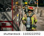 firefighters walking to the... | Shutterstock . vector #1103222552