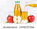 apple juice pouring pour apples ... | Shutterstock . vector #1103237246