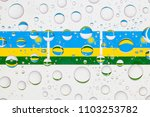flags  of rwanda behind a glass ... | Shutterstock . vector #1103253782