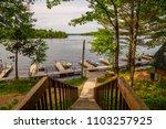 north woods lake dock boats...   Shutterstock . vector #1103257925