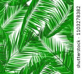 seamless pattern of palm leaves.... | Shutterstock .eps vector #1103278382