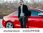 outdoor portrait man with a... | Shutterstock . vector #1103299508