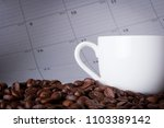 coffee with a calendar on a... | Shutterstock . vector #1103389142