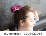 face of a girl with an orchid... | Shutterstock . vector #1103421068