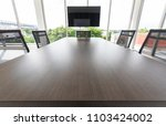 group of black chairs around...   Shutterstock . vector #1103424002