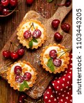 tarts with fresh cherries and... | Shutterstock . vector #1103443205