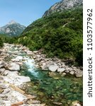 stony bed  teal water   the... | Shutterstock . vector #1103577962