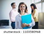 woman standing in front of her... | Shutterstock . vector #1103580968
